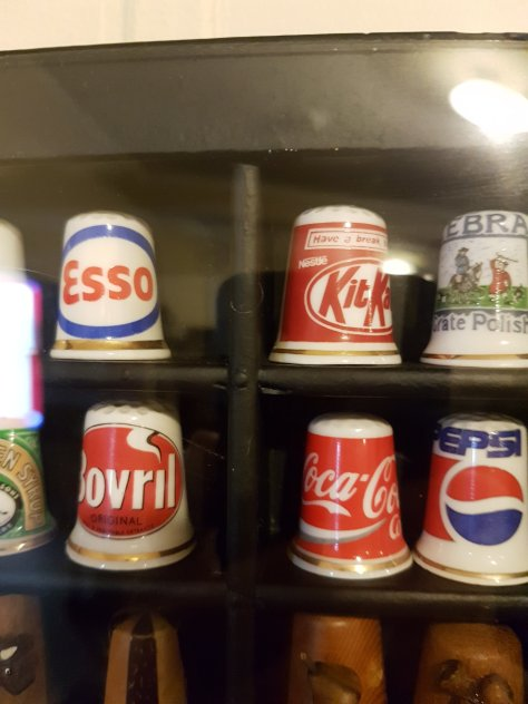 Some branded thimbles as part of the collection