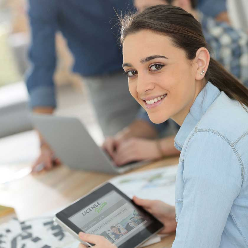 Portrait of student girl using digital tablet
