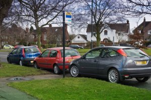 Parked cars blocking a bus stop near the Bowling Green island. Picture: Nick Brickett