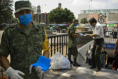 Soldiers hand out masks on the streets of Mexico following the swine flu outbreak. Pic: Eneas De Troya
