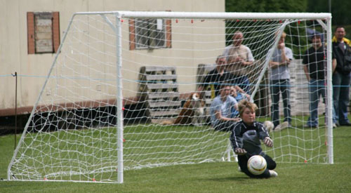 Elsie Baxter saves one of the penalties for Lichfield Diamonds