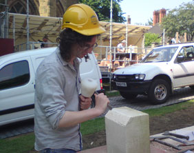 A visitor learns the art of being a stone mason