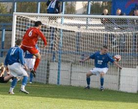 Chris Horton scores against Lancaster City. Pic: Dave Birt