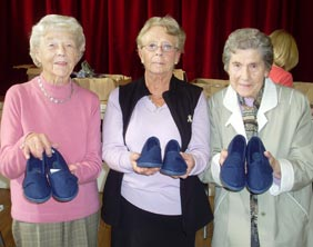 Dawn Morley, Rosemary Hart and Mavis Harris with their new slippers