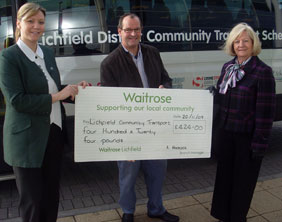 Waitrose's Sarah O'Loughlin, Community Transport volunteer driver Chris Pawsey and Cllr Janet Eagland