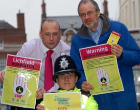 Pub owner Paul Maddox, Richard Lewis and PC Adam Thompson launch Pubwatch in Lichfield