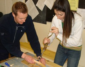 Rob Taylor and Holly Francis building a bird box