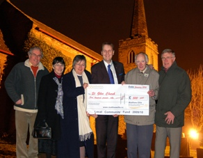 Cllr Matthew Ellis presents the funding cheque