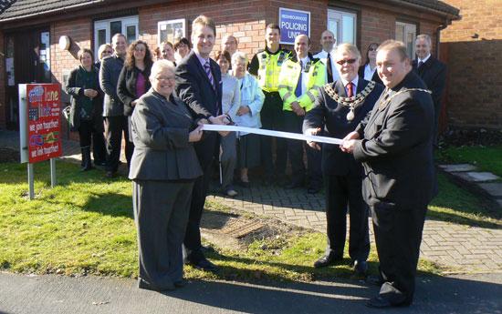Cllr Joseph Powell cuts the ribbon at Mill Lane Link