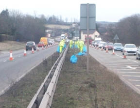 Workers clearing the central reservation on the A5