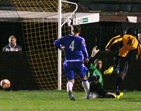 Justin Nisbett scores Rushall Olympic's fourth goal against Chasetown. Pic: Dave Birt