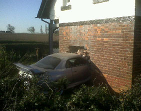 The car that crashed through the side of a house on the Tamworth Road in Lichfield.