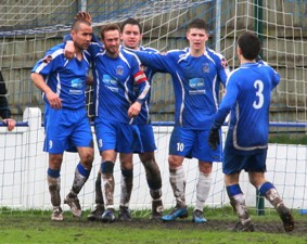 Gary Hay celebrates with his Chasetown team-mates. Pic: Dave Birt