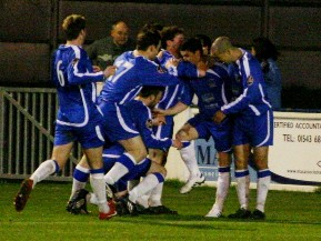 Chasetown FC's players celebrate Dean Perrow's goalscoring return. Pic: Dave Birt