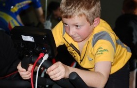 A young competitor tries out the Wattbikes