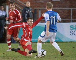 Richard Davies slides in to win the ball. Pic: Dave Birt