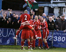 Celebration time for Chasetown's players and supporters after their win at Eastleigh. Pic: Dave Birt