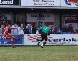 Richard Davies slots home to make it 1-0 to Chasetown. Pic: Dave Birt