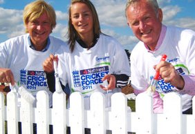 Michael Fabricant MP, Danielle Wyatt and Dennis Amiss give the fence a new coat of paint.
