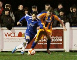Chasetown striker Dean Perrow races away from a defender. Pic: Dave Birt