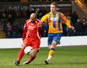 Jimmy Turner clears the ball. Pic: Dave Birt