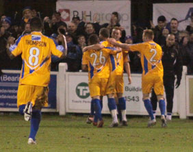 Mansfield Town players celebrate after going 2-1 in front. Pic: Dave Birt