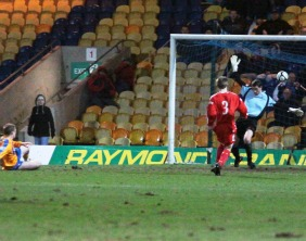 Danny Mitchley makes the win secure for Mansfield Town. Pic: Dave Birt