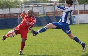 Chasetown's Jimmy Turner clears the ball. Pic: Dave Birt