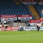 Matthew Wolfenden puts the ball past Ryan Price. Pic: Dave Birt