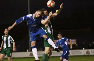 Karl Edwards battles for the ball in the air. Pic: Dave Birt