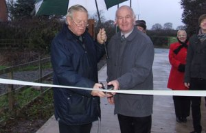 Cllr Neil Roberts and Dave Henn cutting the ribbon