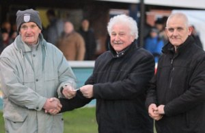 Mike Joiner hands over the cheque to Mervyn Rowe