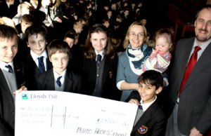Maple Hayes pupils Henry Bartlett-Johns, Joel Barker, Matthew Crossley, Leah Pride and Anwar Syed join headmaster Dr Daryl Brown to hand the cheque over to Stepping Stones volunteer Sarah Sutton and her daughter Zoe