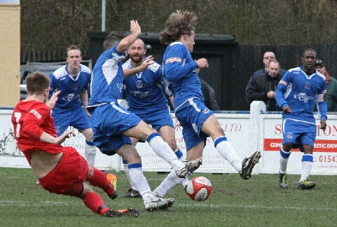 Chasetown's defenders charge down a shot. Pic: Dave Birt