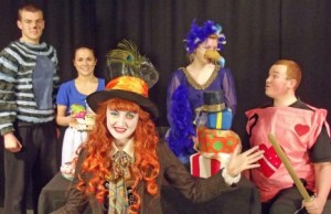 Scott Harrison as the Cheshire Cat (Judas), Natasha Pryjmachuk (costume designer) dressed as Alice (disciple), Amanda Pinson as the Mad Hatter (Jesus), Lydia Clements as the Dodo (James) and Ashley Booker as a Card Guard (Malchus)