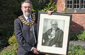 Cllr Ken Humphreys with a picture of his grandfather Hubert Humphreys