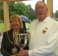 Cllr Janet Eagland hands the trophy to Hank Vyse