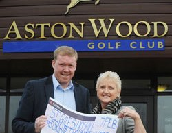 Steve Staunton hands over a cheque to Lyn Shiel from St Giles Hospice