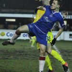 Paul Sullivan tries to hold off a defender. Pic: Dave Birt