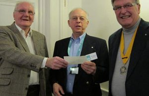 Ken Sharman an Mike Cook hand over the cheque to ShelterBox