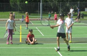 Young players testing out the refurbished Beacon Park tennis courts