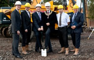 Mark Greasby, Carl Allen, Cllr David Leytham, David Clancy, Neil Coote, John Bates and Sam Patel get work underway on the new Lichfield city centre hotel