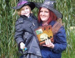 Park ranger Stacey Coleman gets ready for the Halloween trail with a young visitor