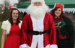 Elves Katy Humpage and Stacey Coleman with Santa