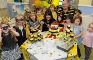 Children at the Busy Bees nursery in Burntwood celebrating with co-founders Marg Randles and John Woodward
