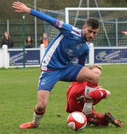 Luke Chapman holds off a challenge. Pic: Dave Birt