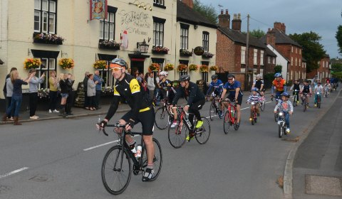 The police cyclists are joined by other riders for the final part of their charity challenge