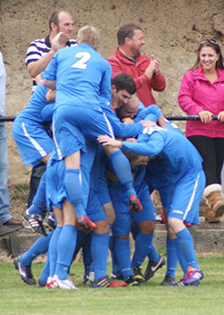 Lichfield's players celebrate a Mark Rose goal. Pic: Mick Tyler