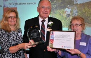 Volunteers from Elford Walled Garden collecting awards