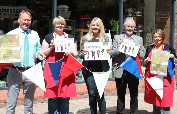 Jon Arrowsmith (Retail Ops Project Manager for Central England Co-operative), Vicky Woolstone (The Kitchen Shop), Michelle Baker (Lichfield's BID Development Manager), Richard Lewis (President of Lichfield Chamber of Trade and Commerce) and Lizzy Braine (The Kitchen Shop) with the bunting